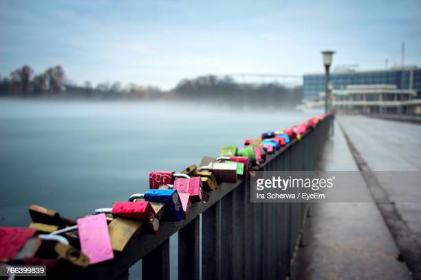 padlocks on footbridge over river against cloudy sky - hanover germany stock pictures, royalty-free photos & images