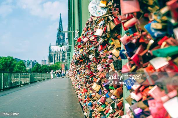 padlocks on the hohenzollern bridge in cologne - cologne stock pictures, royalty-free photos & images