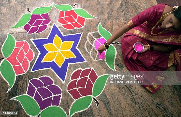 Padma completes a 'Rangoli' to celebrate the Hindu festival of Diwali at her home in Bangalore 14 November 2001 Hindus decorate their houses with...