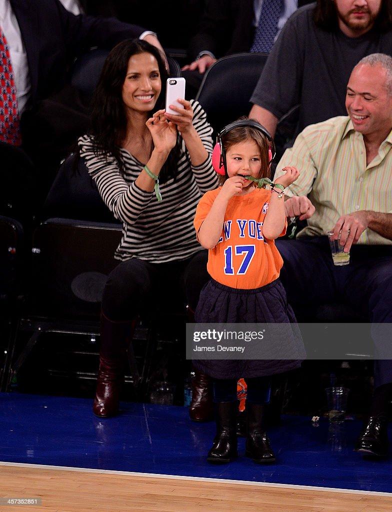 Padma Lakshmi and daughter Krishna Lakshmi-Dell attend the Washington Wizards vs New York Knicks game at Madison Square Garden on December 16, 2013 in New York City.