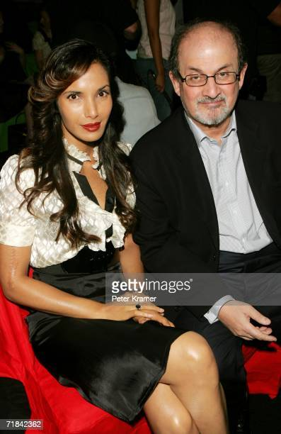 Padma Lakshmi and Salman Rushdie pose in the front row at the Diane Von Furstenberg Spring 2007 fashion show during Olympus Fashion Week at the Tent...