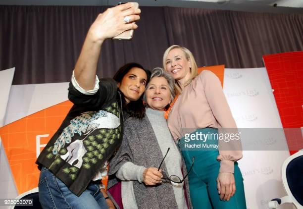 Padma Lakshmi Former US Senator Barbara Boxer and Chelsea Handler take a selfie onstage at EMILY's List's Resist Run Win PreOscars Brunch on February...