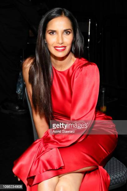 Padma Lakshmi poses backstage during The American Heart Association's Go Red for Women Red Dress Collection 2019 at Hammerstein Ballroom on February...
