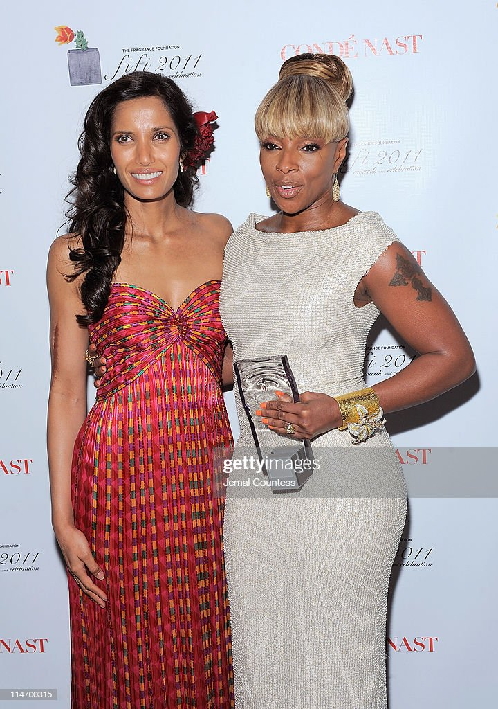 Padma Lakshmi (L) poses with Mary J. Blige backstage at the 2011 FiFi Awards at The Tent at Lincoln Center on May 25, 2011 in New York City.