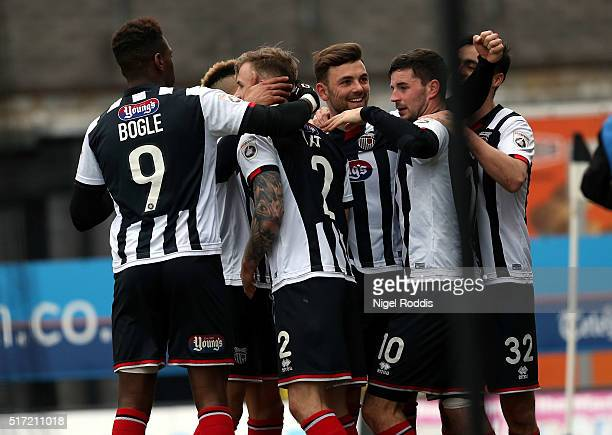 Padraig Amond of Grimsby Town celebrates scoring his second goal with teamates during the FA Trophy Semi Final Second Leg between Grimsby Town and...