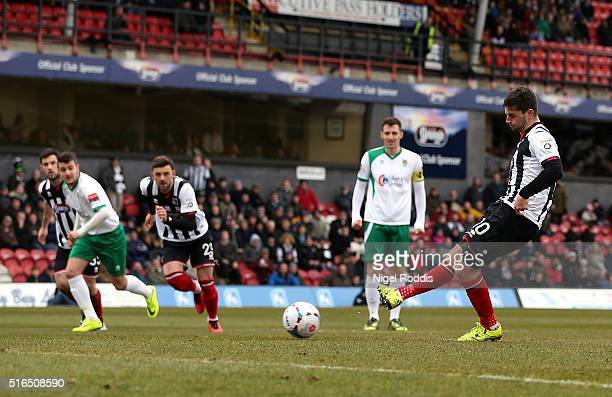 Padraig Amond of Grimsby Town shoots to score a penalty during the FA Trophy Semi Final Second Leg between Grimsby Town and Bognor Regis at Blundell...