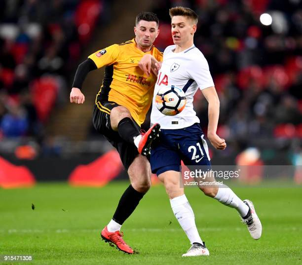 Padraig Amond of Newport County and Juan Foyth of Tottenham Hotspur battles for possesion during The Emirates FA Cup Fourth Round Replay match...
