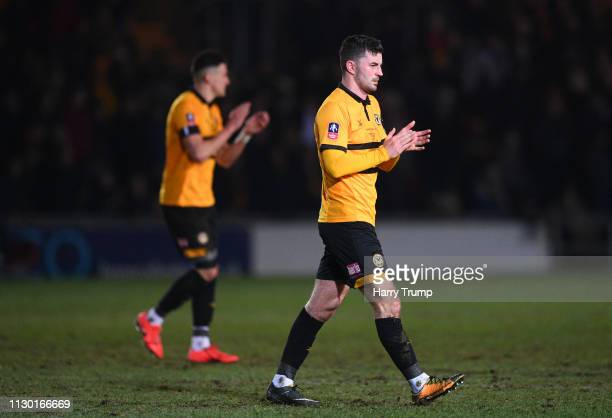 Padraig Amond of Newport County applauds the fans at the final whistle during the FA Cup Fifth Round match between Newport County AFC and Manchester...