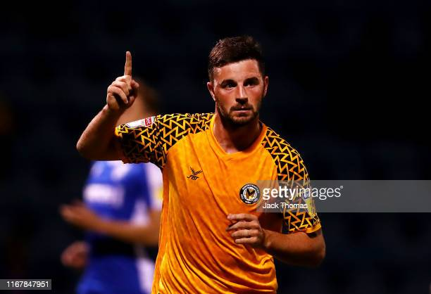 Padraig Amond of Newport County celebrates after scoring his team's second goal from the penalty spot during the Carabao Cup First Round match...