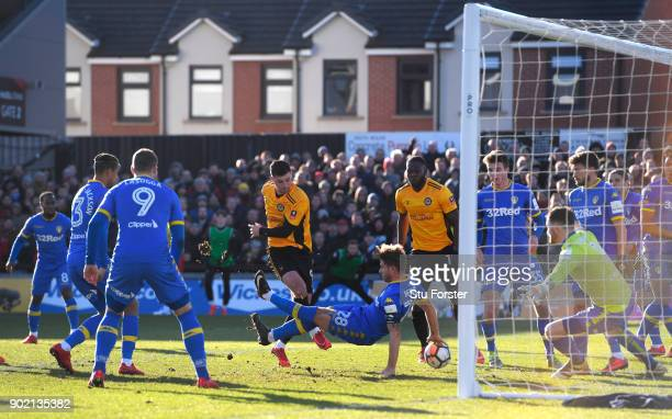 Padraig Amond of Newport County shoots and misses during The Emirates FA Cup Third Round match between Newport County and Leeds United at Rodney...