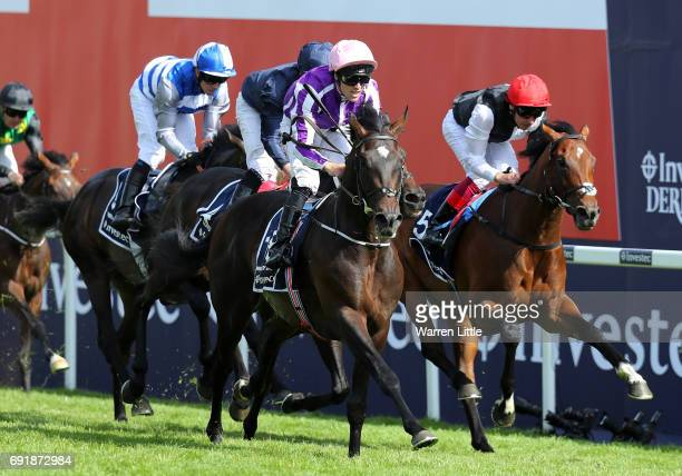 Padraig Beggy riding Wings Of Eagles races to victory during the Investec Derby at Epsom Racecourse on June 3 2017 in Epsom England