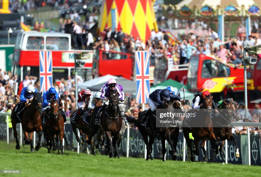 Padraig Beggy riding Wings Of Eagles (C) races to victory during the Investec Derby at Epsom Racecourse on June 3, 2017 in Epsom, England.
