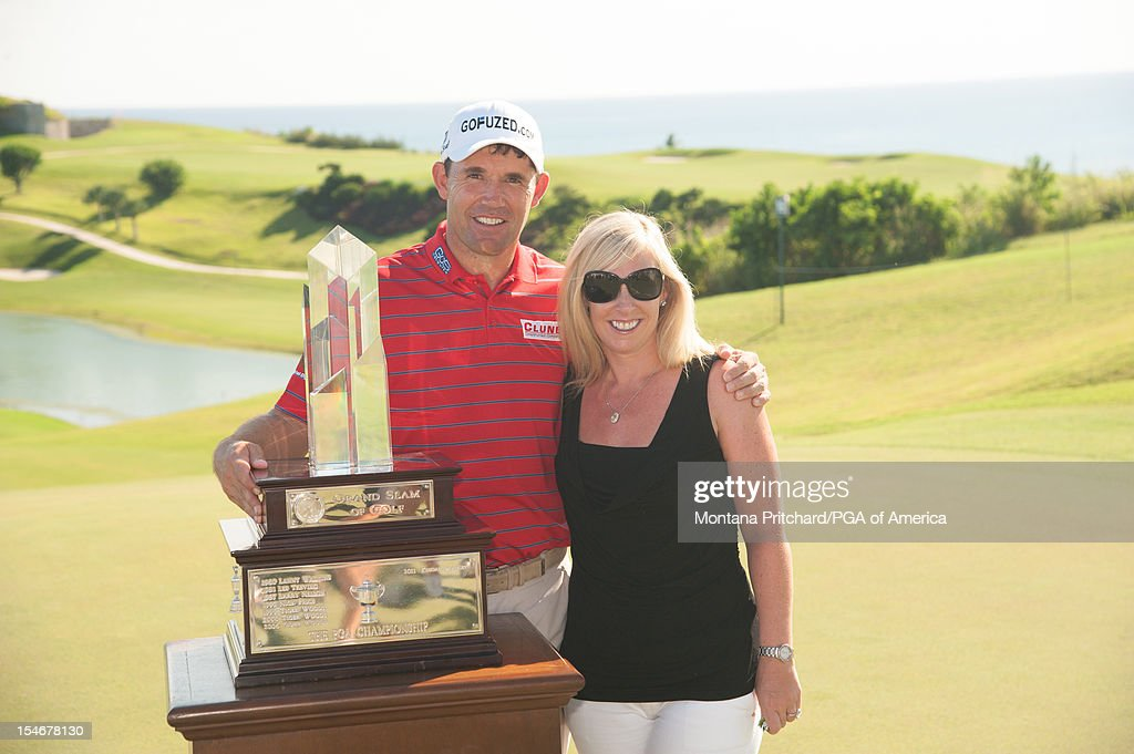 Padraig Harrington (L) and his wife Caroline Harrington pose with the tophy during the Award Ceremony at The Port Royal Golf Club for the 30th Grand Slam of Golf on October 24, 2012 in Southampton, Bermuda.