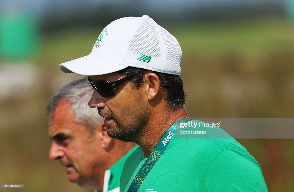 Padraig Harrington (R) and Paul McGinley follow the play of Leona Maguire of Ireland during the third round of the Women's Individual Stroke Play golf on Day 14 of the Rio 2016 Olympic Games at Olympic Golf Course on August 19, 2016 in Rio de Janeiro, Brazil.