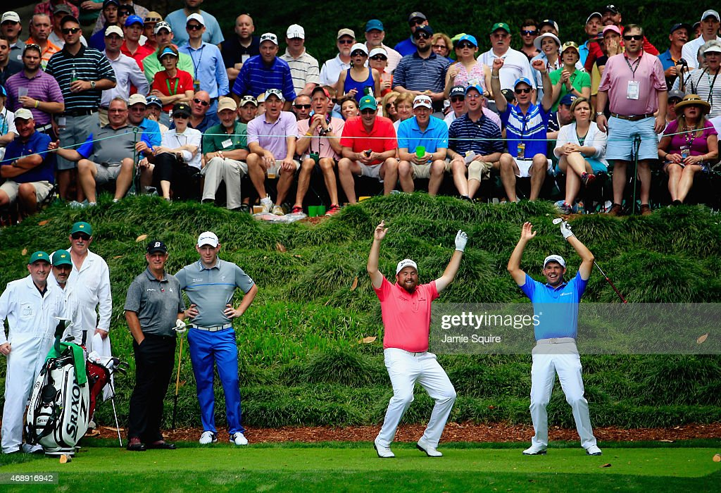Padraig Harrington and Shane Lowry of Ireland react to a shot during the Par 3 Contest prior to the start of the 2015 Masters Tournament at Augusta National Golf Club on April 8, 2015 in Augusta, Georgia.