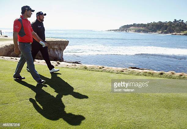 Padraig Harrington and Shane Lowry of Ireland walk off the 18th tee during the first round of the ATT Pebble Beach National ProAm at the Pebble Beach...