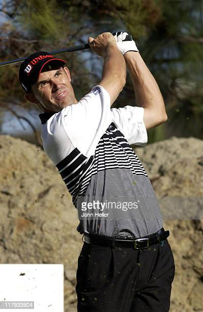 Padraig Harrington Defending Champion of the 2002 Target World Challenge watches his drive off the tee at the fifteenth during the third round of...