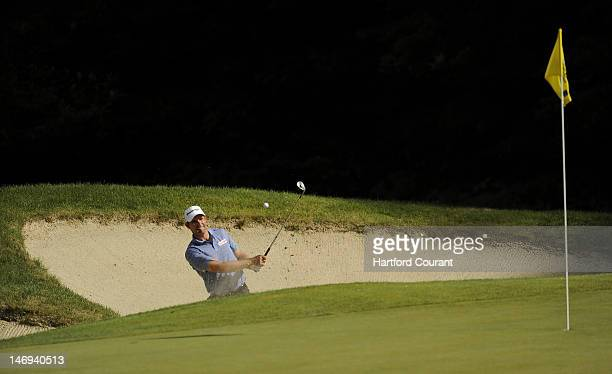 Padraig Harrington hits out of the greenside bunker on the 14th during the third round of the 2012 Travelers Championship golf tournament at the TPC...