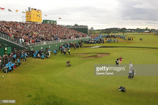 Padraig Harrington hugs his son Patrick on the 18th green after winning the 136th Open Championship in Carnoustie Scotland at Carnoustie Golf Links...
