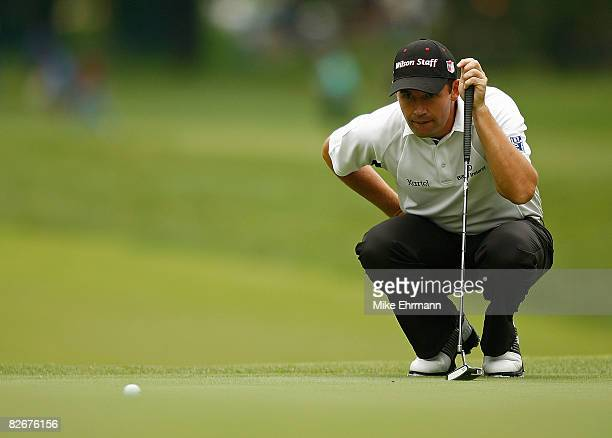 Padraig Harrington lines up a putt on the 7th hole during the weatherdelayed first round of the BMW Championship on September 5 2008 at Bellerive...