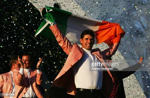Padraig Harrington of Europe holds aloft the Irish flag during the closing ceremony after Europe win the Ryder Cup by a score of 18 1/2 - 9 1/2 on...