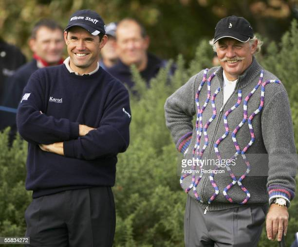 Padraig Harrington of Ireland and businessman Dermot Desmond share a joke while waiting to the play the 12th hole during the third round of the...