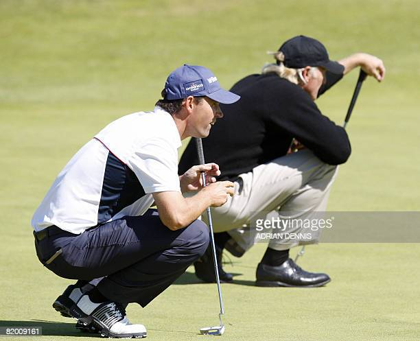 Padraig Harrington of Ireland and Greg Norman of Australia in action on the 5th green in the fourth round at The Open golf tournament at Royal...
