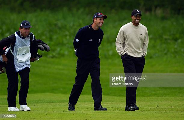 Padraig Harrington of Ireland and Tiger Woods of the USA share a joke whilst walking down the 17th fairway during the first round of The SAP Deutsche...