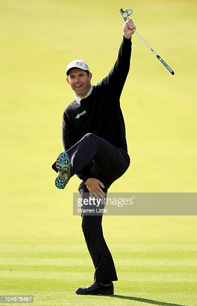 Padraig Harrington of Ireland celebrates after holing a putt on the first green during the practice round of The Alfred Dunhill Links Championship at...