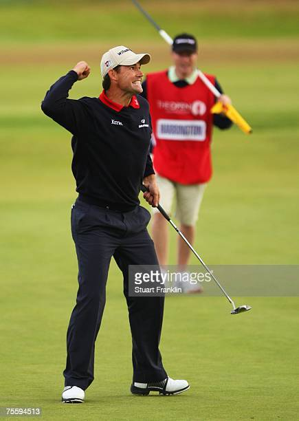 Padraig Harrington of Ireland celebrates with his caddie Ronan Flood after defeating Sergio Garcia of Spain in the playoff to win The 136th Open...