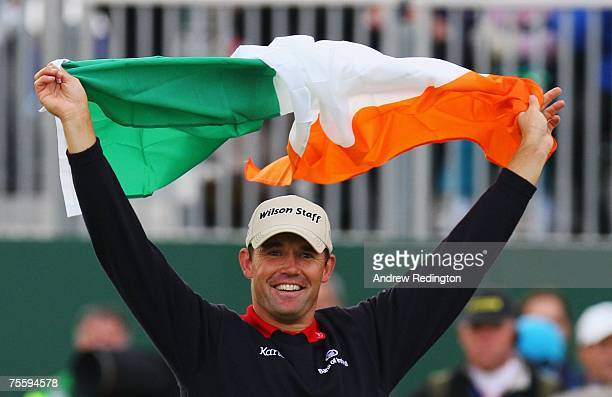 Padraig Harrington of Ireland celebrates with the Irish flag after defeating Sergio Garcia of Spain in the playoff to win The 136th Open Championship...