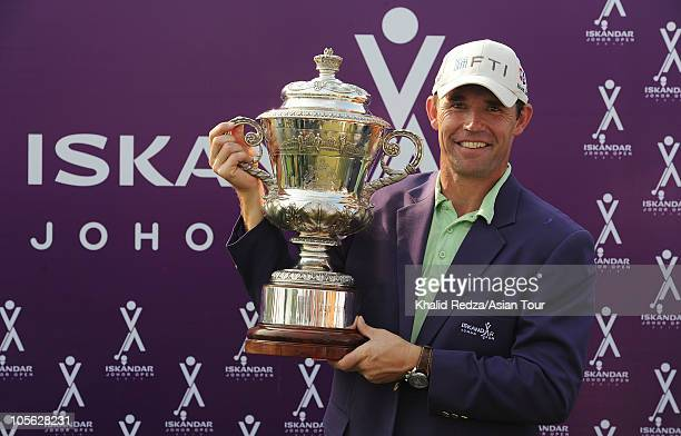 Padraig Harrington of Ireland celebrates with the winners trophy on the final day of the Iskandar Johor Open at Horizon Hills Golf Country Club on...