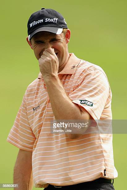 Padraig Harrington of Ireland grimaces on the 10th green during the first round of the Maybank Malaysian Open 2006 at Kuala Lumpur Golf and Country...