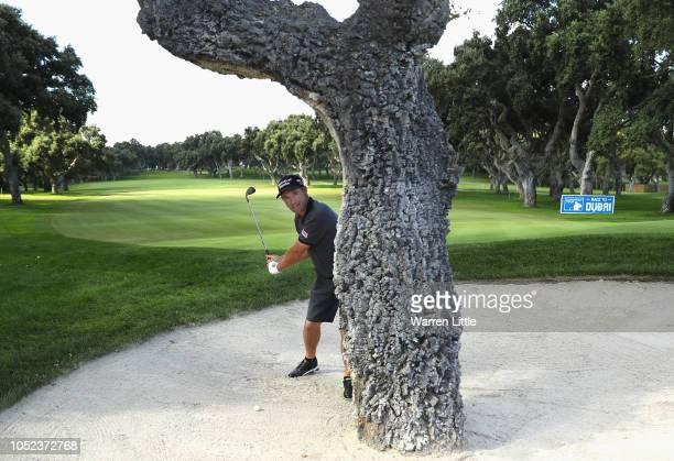 Padraig Harrington of Ireland has a bit of fun playing out of the ninth greensie bunker ahead of the Andalucia Valderrama Masters at Real Club...