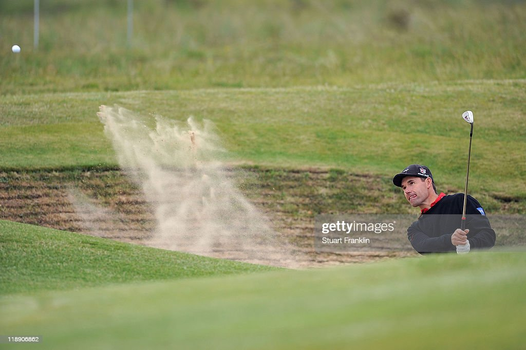 Padraig Harrington of Ireland hits a bunker shot during the second practice round during The Open Championship at Royal St. George's on July 12, 2011 in Sandwich, England. The 140th Open begins on July 14, 2011..