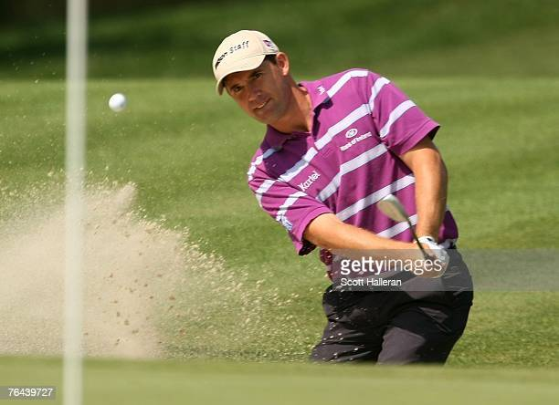Padraig Harrington of Ireland hits a bunker shot on the 14th hole during the first round of the Deutsche Bank Championship, the second event of the...