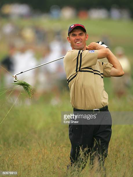Padraig Harrington of Ireland hits a shot from the rough on the fourth hole during the third round of the 104th U.S. Open at Shinnecock Hills Golf...