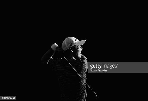 Padraig Harrington of Ireland plays a shot on the range after the continuation of the delayed second round of The Porsche European Open at Golf...