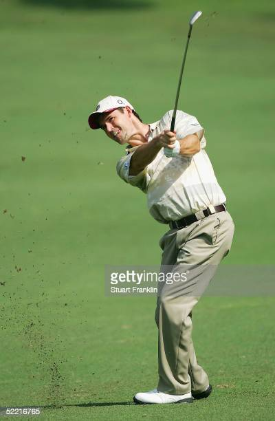 Padraig Harrington of Ireland plays his approach shot on the first hole during the third round of The Carlsberg Malaysian Open at Saujana Golf Resort...