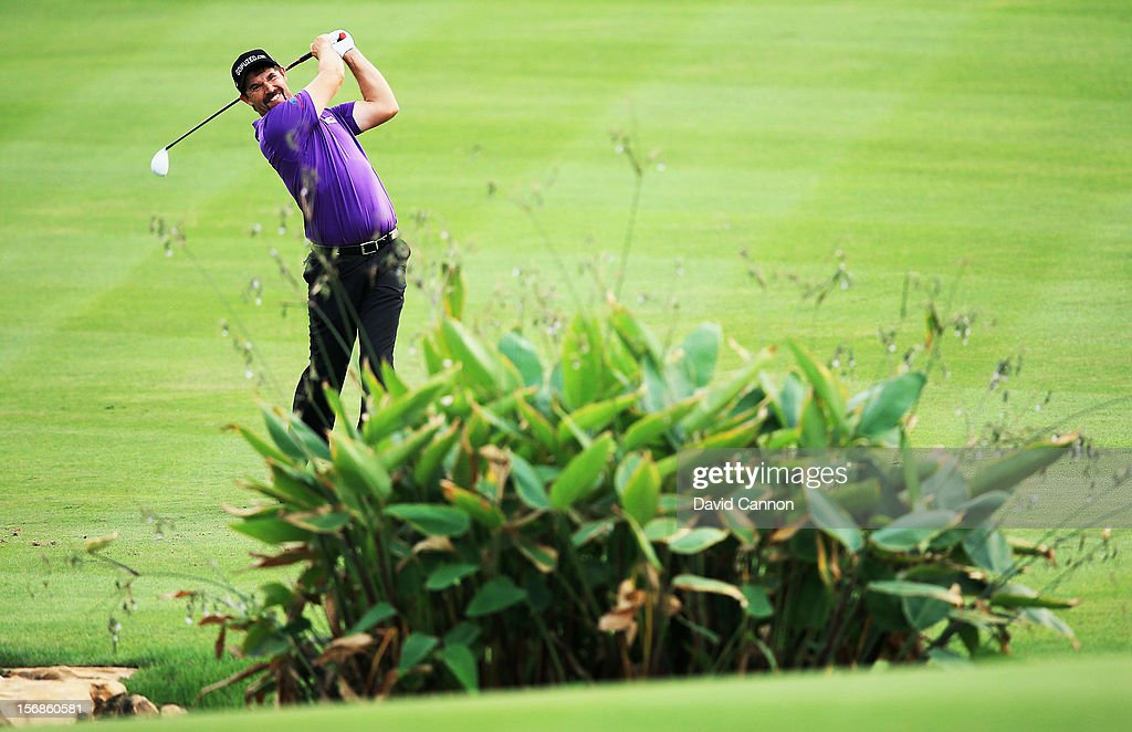 Padraig Harrington of Ireland plays his second shot at the par 5, 18th hole during the second round of the 2012 DP World Tour Championship on the Earth Course at Jumeirah Golf Estates on November 23, 2012 in Dubai, United Arab Emirates.