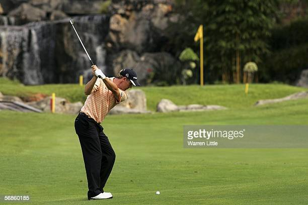 Padraig Harrington of Ireland plays his second shot into the 17th green during the first round of the Maybank Malaysian Open 2006 at Kuala Lumpur...