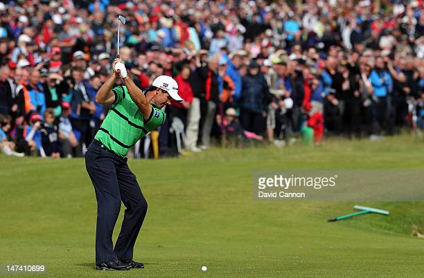 Padraig Harrington of Ireland plays his second shot on the par 4, 18th hole during the second round of the 2012 Irish Open held on the Dunluce Links...