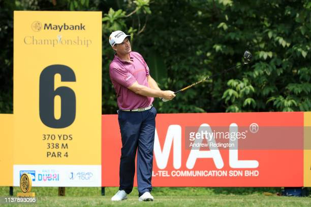Padraig Harrington of Ireland plays his shot on the 6th tee during Day Four of the Maybank Championship at Saujana Golf Country Club Palm Course on...