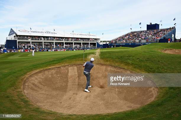 Padraig Harrington of Ireland plays his third shot from a bunker on the eighteenth hole during Day One of the Dubai Duty Free Irish Open at Lahinch...