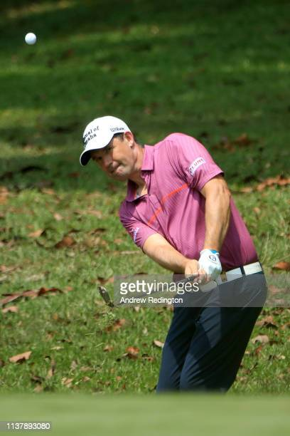 Padraig Harrington of Ireland plays his third shot on the 6th hole during Day Four of the Maybank Championship at Saujana Golf Country Club Palm...