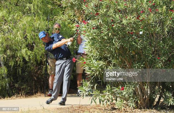 Padraig Harrington of Ireland plays out of trouble on the 9th hole after taking a drop during day two of the Portugal Masters at Dom Pedro Victoria...