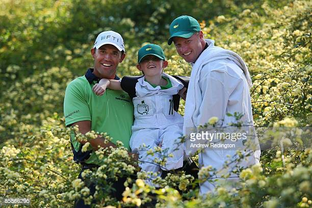 Padraig Harrington of Ireland pose alongside his son Patrick and caddie Ronan Flood during the Par 3 Contest prior to the 2009 Masters Tournament at...