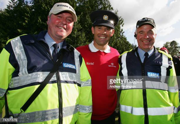 Padraig Harrington of Ireland poses alongside two policemen after winning the Irish Open on May 20 2007 at the Adare Manor Hotel and Golf Resort in...