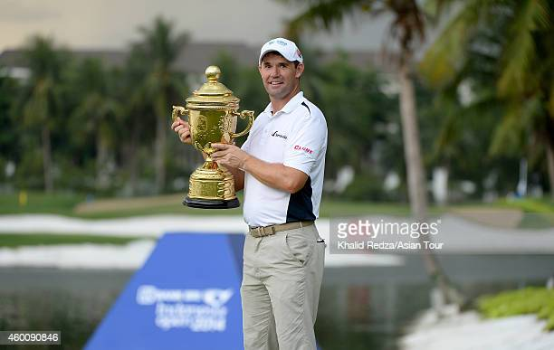 Padraig Harrington of Ireland poses with the trophy after winning during round four of the Indonesia Open at Damai Indah Golf Pantai Indah Kapuk...