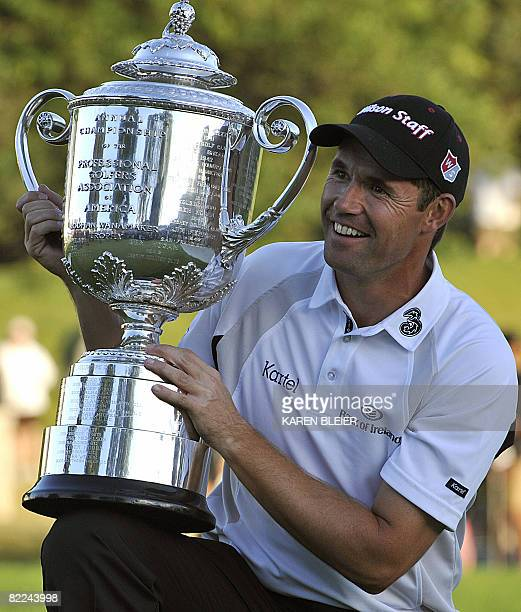 Padraig Harrington of Ireland poses with the Wanamaker Trophy after winning the 90th PGA Championship August 10 2008 at the Oakland Hills Country...